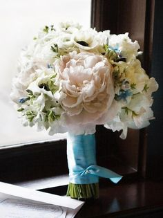 pink white and blue bouquet