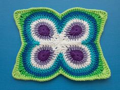 butterfly-peacock-mandala-finished-blocked