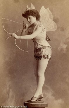 Vintage Burlesque from the 1890's. You can definitely see the theatrical and erotic parody elements of burlesque here. I totally love the little hat.