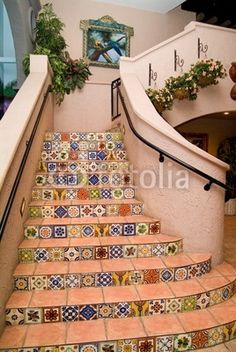 Spanish style staircase from outdoor courtyard to upstairs sun deck
