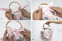 tas gemaakt van een doek en ronde bamboehandvatten (furoshiki)
