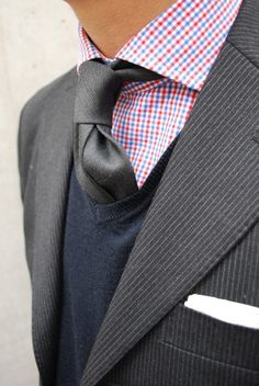 Tie, shirt, sweater, jacket combo