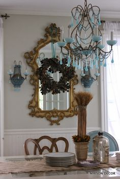 For Thanksgiving decor, tie a ribbon on a fall wreath and hang from your dining room mirror! #mirror #thanksgivingdecor #sponsored