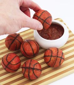 Basketball Calzones ~ They're tiny bites of cheese and pepperoni in balls of pizza dough made using a cake pop pan. link to recipe on page