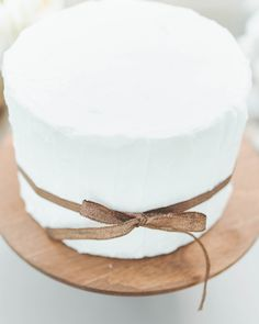 cake tied with a bow // photo by Paper Antler // http://ruffledblog.com/modern-nouveau-wedding-ideas
