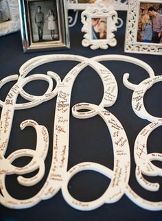Wooden Monogram as a Guest Book -- Great idea! You can later hang it in your home. :)