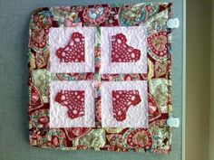 Valentine wall hanging... so cute; it looks like she used bits from a doily ~ quilt by Patty Conrad