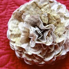 I love these crafts that use old books and pages.  This is a flower made from book pages.