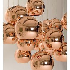 Rose gold bubble pendant lighting.