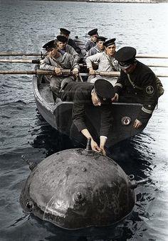 Russian sailors disarm sea mine.