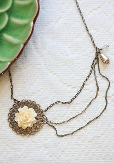 """Victorian Filigree Indie Necklace 45.99 at shopruche.com. Indie made by Amono Studio, this antiqued gold colored necklace is adorned with delicate detail and a beautifully carved resin rose.  16-19"""" long"""