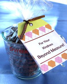 """""""Beyond Measure"""" -Measuring cup filled with chocolate, cookies, or cookie mix."""