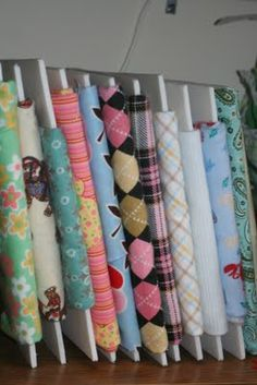 Organize your fabric by cutting foam core to fit within a book case. Wrap your fabric - and voila a d-i-y fabric bolt.