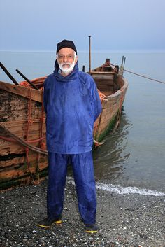 A fisherman and his boat at Caspian Sea,near Ramsar,Iran