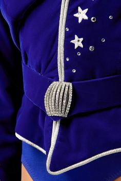"""The """"Velvet March"""" is a patriotic look designed by Deborah Newhall and was introduced by the Rockettes in 1999. This look has been worn at various milestone events. #rockettes #NYC #costumes #dancers #glamorous #white #blue #patriotic #stars #stripes #silver #velvet"""