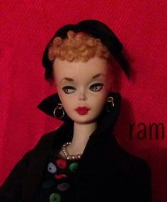 An unusual hand painted number 2 Barbie from the collection of Rosalie A. McFarlane.