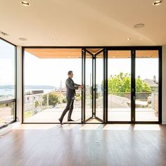 Residential Folding, Swing; Multi-Slide Doors | LaCantina Doors.  La Cantina publishes their budget cost for a 9'W x 7'H three-panel system at $6,000 plus taxes, shipping, delivery, and installation. That's at least 2x PLUS the structural steel and design to support it.