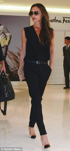 Model behaviour: Victoria looked great in her black ensemble having changed from her earlier yellow jacket