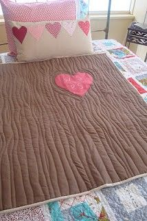 Sew a Tree quilt with initials carved in it. No straight lines needed.