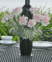 You transform the base of your plain looking umbrella poles into elegant floral centerpieces