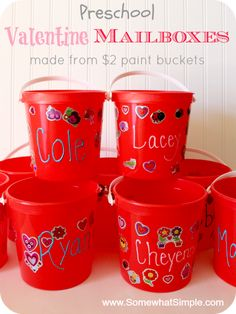 Simple Valentine Mailbox idea- perfect for preschoolers! A 2 dollar paint bucket from #Lowes decorated with Puffy Paint names and stickers from the dollar store. Idea from www.SomewhatSimple.com #lowescreator