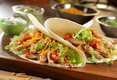 Seasoned chicken breasts and onions are slow-cooked in a savory Mexican-inspired broth resulting in fork-tender chicken. Shred the chicken, add some tomato paste and you've got the perfect filling for chicken tacos that are sure to become a weeknight favorite!