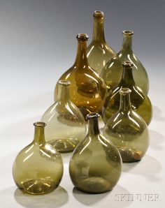 Eight Free-blown Glass Chestnut Bottles, probably New England, 1790-1830, olive and olive-amber colored bottles with applied lip bands amber and olive, glasses, 17901830, new england, appli lip, lips, bottles, color bottl, chestnut bottl