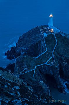 The South Stack Lighthouse at dusk on the island of Anglesey in North Wales, UK