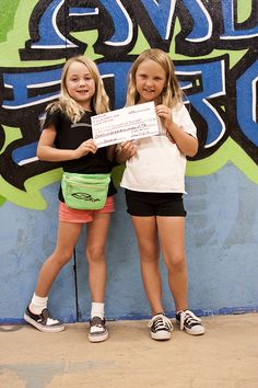 Kiala Nelson and Lucy English present a check from the Koala Foundation to Grind Out Hunger.