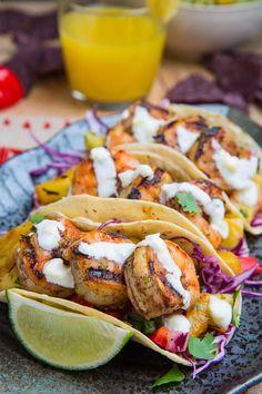 Jerk Shrimp Tacos with Pineapple Salsa, Slaw and Pina Colada Crema - mmm!