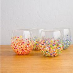 5 Fun Wine Glasses: enamel acrylic paint/Q-Tips; parchment paper; cookie sheet.  Set glasses upside down & dab with 1st layer of colored dots; let dry; add 2nd layer; bake in 350 oven for 30 minutes & leave in with heat off for at least an hour more.