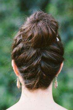 braid + topknot, photo by Lad & Lass http://ruffledblog.com/villa-paradiso-wedding #wedding #hair #bridalhair