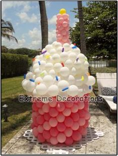 Party Decorations Miami | Balloon Sculptures   Cupcake balloon sculpture 8ft tall. Great birthday party decoration idea.