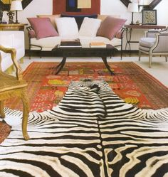 Layering area rugs layer rug, living rooms, color palettes, decorative pillows, living room rugs, cowhide rugs, throw pillows, zebra, oriental rugs