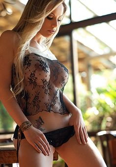 Sexy blonde girl with kinky black see through lingerie. More sexy models at http://sexy-calendars.net