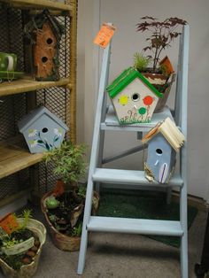 up cycled ladders and birdhouses and mini terracotta gardens