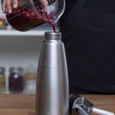 We use a whipping siphon with carbon dioxide cartridges to make our Carbonated Cranberries.
