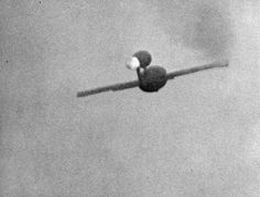A German Fiesler Fi 103 flying-bomb (V1) in flight, as seen by the gun camera of an intercepting RAF fighter aircraft, moments before the fighter destroyed the V1 by cannon fire.