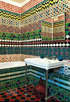 Mix many styles of mosaic tile to create a masterpiece in the bathroom that surely makes a statement
