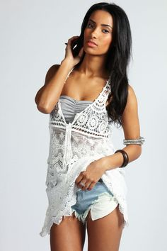 Another example of vests, which I love. Crochet vest are so beautiful. I have just started out crocheting and would love to make vests like these.