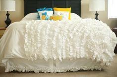 white ruffled bed