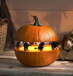 """Create """"Spook-tacular"""" silhouettes with Witch/Cat Pumpkin Pegs™. They are reusable and fun! #halloween #DIY #plaidcrafts"""