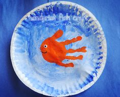 Paint a paper plate blue to represent the ocean, then make a colorful handprint over top of the blue. Add a googly eye and a mouth to complete your fish. home preschool, ocean crafts, the ocean, fish crafts, paper plate crafts, hand prints, paper plates, art projects, kid