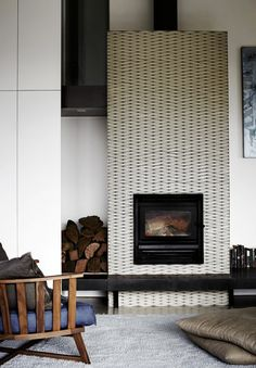 black and white tiles fireplace...remodelista
