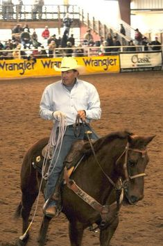 Country Singer George Straight participates in Team Roping.