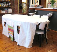 Brilliant. Tablecloth 'playhouse' for kids