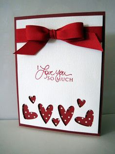 Use a triple-heart punch, a layer of dotted paper and a smart red ribbon on this handmade valentine's card.