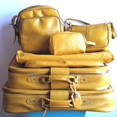 Saw this mustard yellow luggage and immediately thought of you, @Sarah Chintomby Chintomby Chintomby Chintomby Hurt.