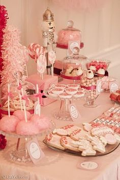 Pink christmas party dessert table.