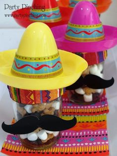 Blogger says: Mexican S'mores Mix!  I combined Cinnamon Teddy Grahams, chocolate chips and Jet-Puffed mini marshmallows.  Packed into these little canning jars, I added a 'stache, sombrero and ribbon - it made for a fun festive favor